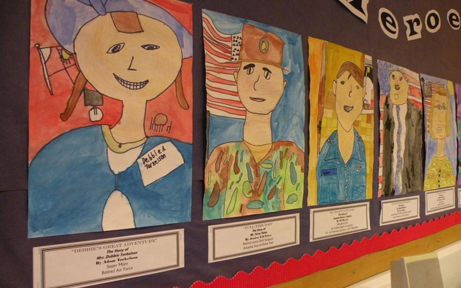 Water-color pictures adorn the walls of Karen Griffis' classroom at Feltwell Elementary School. Each student painted a picture of his or her local hero for the authors tea.