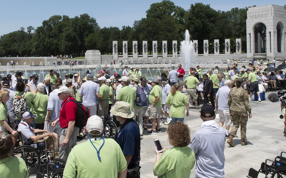 Veterans and their guardians participating in an Honor Flight gather at the National World War II Memorial in Washington, D.C., on Wednesday, July 10, 2019. Because of the coronavirus pandemic, the Honor Flight Network said Thursday, June 11, 2020, that it would cancel all trips to the nation's capital through the end of 2020.