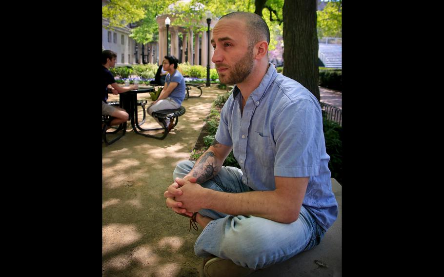 Iraq War veteran Kristofer Goldsmith, sits in a campus park after his last final exam of the semester at Columbia University in New York on May 9, 2018.